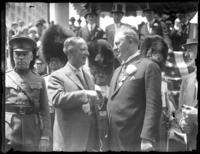 Al Smith shaking hands with unidentified (British?) official, probably New York City, undated (ca. 1920)