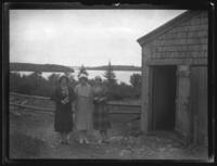 Odessa France Bjorkman and two unidentified women standing next to a country cabin or shed, undated (ca. 1925-1930).