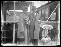 Unidentified elderly couple pose on the deck of the Drottningholm out of Gӧteborg, Sweden, undated (ca. 1920-1925).