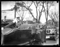 American Legion officials in an open-topped car, Armistice Day parade, Cleveland, Ohio, 1918.