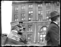 General Armando Diaz and an unidentified military official riding in the back of an open car. Probably the dedication of the Simón Bolívar statue in Central Park, New York City, April 1921.