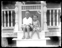 Two unidentified children sitting on the front steps of a house, Savannah, Georgia or Jacksonville, Florida, undated, (ca. 1920).