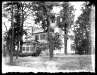 Unidentified house surrounded by trees, Savannah, Georgia or Jacksonville, Florida, undated, (ca. 1920).