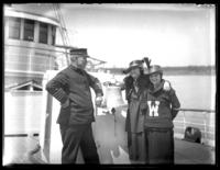 Odessa France Bjorkman and an unidentified woman pose on the deck of a ship with a member of the crew, probably Savannah, Georgia, undated (ca. 1920).