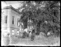 Odessa France Bjorkman posing in front of an abandoned house, Savannah, Georgia, undated (ca. 1920).
