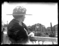 Odessa France Bjorkman looking at ostriches in a pen, Savannah, Georgia, undated (ca. 1920).