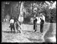 Odessa France Bjorkman and an unidentified woman photographing a group of African-American children, Savannah, Georgia, undated (ca. 1920).