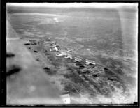 Aerial view of several one-man planes in an unidentified field, undated (ca. 1920).