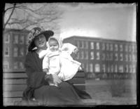 Odessa France Bjorkman seated on a bench holding baby Virginia Bjorkman, Baltimore, Maryland (?), undated (ca. 1920-1925).