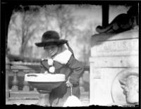 Unidentified child drinking from a water fountain, Baltimore, Maryland (?), undated (ca. 1920-1925).