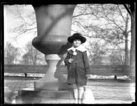 Unidentified child posed beside an urn in a park, Baltimore, Maryland (?), undated (ca. 1920-1925).