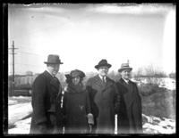 Three unidentified men and a woman in winter coats, New York City (?), undated (ca. 1920-1925).