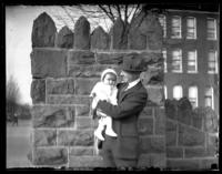 Fritz Bjorkman holding an infant Virginia Bjorkman, Baltimore, Maryland (?), undated (ca. 1920-1925).
