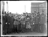 Marshal Ferdinand Foch and John Pershing shaking hands in front of an unidentified group of soldiers and civilians standing near the docks, New York City, undated (ca. 1921).