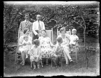 Ernest Bjorkman (?), Herman Bjorkman, Odessa France Bjorkman, Anna E. Bjorkman, an unidentified woman, Virginia Bjorkman, Peggy Bjorkman (infant), William Bjorkman, and an unidentified boy in chairs in the garden, Yonkers, N.Y., undated (ca. 1930).