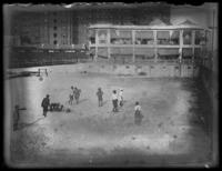 High-angle view of a group of African American boys playing in an empty swimming pool, Atlantic City, N.J., undated (ca. 1920-1925).