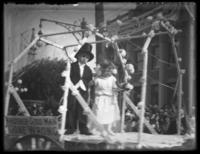 Unidentified boy and girl dressed as newlyweds, riding in a parade float, Atlantic City, N.J. (?), undated (ca. 1920-1925).