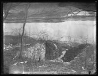 Ruins of an old house in an unidentified field, Eastchester, N.Y., undated (ca. 1920-1925).