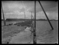 Unidentified people on a damaged dock, undated (ca. 1930-1935). Possibly Holland Island, Maryland.