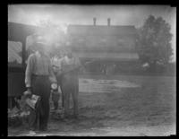 Unidentified workmen standing in front of a house, undated (ca. 1930-1935).