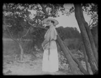 Odessa France Bjorkman standing next to a tree, Baltimore, Maryland, undated (ca. 1917-1918).