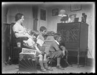 Odessa, Peggy, Virginia, and William Bjorkman listening to the radio, undated (ca. 1930-1935).