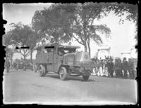 Armored transport vehicle in a military parade along Riverside Drive near the Soldiers' and Sailors' Monument, New York City, undated (ca. 1917-1919).
