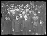 Crowd of military and civilian officials, including Marshal Joseph Joffre and Field Marshal Sir John French, gathered on the steps of an unidentified building, New York City (?), undated (ca. 1917-1919).