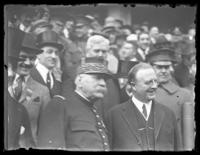 Crowd of military and civilian officials, including Marshal Joseph Joffre, gathered on the steps of an unidentified building, New York City (?), undated (ca. 1917-1919).