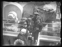 Marshal Joseph Joffre standing with other officials on the gangplank of an unidentified ship, New York City (?), undated (ca. 1917-1919).
