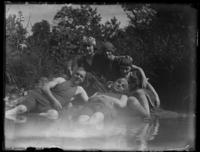 Odessa France Bjorkman and four unidentified young men and women in bathing costumes sitting on the shore of a creek, undated (ca. 1917-1918).