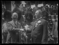 Al Smith shaking hands with unidentified (British?) official, probably New York City, undated (ca. 1917-1920).