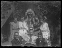Chief Oskomon posing with a group of people (possibly the France family), Baltimore, Maryland, undated (ca. 1917-1918).