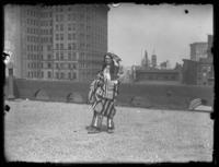 Chief Oskomon on the roof of a building, Baltimore, Maryland, undated (ca. 1917-1918).