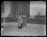 Chief Oskomon and unidentified woman on the roof of an unidentified building, Baltimore, Maryland, undated (ca. 1917-1918).