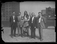Chief Oskomon posing for a group portrait with four unidentified men on the roof of a building, Baltimore, Maryland, undated (ca. 1917-1918).