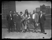 Chief Oskomon and six unidentified men and women on the roof of a building, Baltimore, Maryland, undated (ca. 1917-1918).