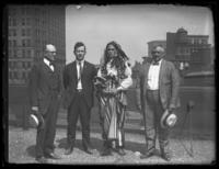 Chief Oskomon posing for a group portrait with three unidentified men on the roof of a building, Baltimore, Maryland, undated (ca. 1917-1918).