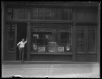 Unidentified Lord Electric Company storefront, Baltimore (?), undated (ca. 1920).  Unidentified man posing in doorway.