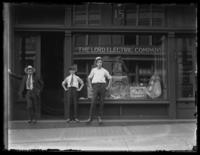 Unidentified Lord Electric Company storefront, New York City or Baltimore (?), undated (ca. 1920). Two unidentified men and a boy pose in front.