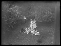 Odessa France Bjorkman in a garden with unidentified children, singing, probably Yonkers, N.Y., undated (ca. 1935)