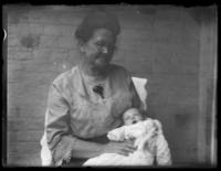 Anna E. Bjorkman holding an unidentified infant, undated (ca. 1920-1929).