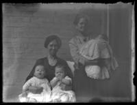 Anna E. Bjorkman and another unidentified older women holding three infants, undated (ca. 1920-1929).