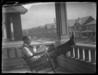 Fritz E. Bjorkman leaning back in a rocking chair on a porch, possibly Yonkers, N.Y., undated (ca. 1916-1920).