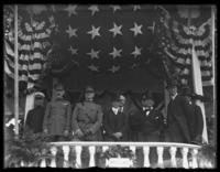 General John J. Pershing in the viewing stand with other military and civilian officials, including Franklin Delano Roosevelt (right), at a victory parade, Washington D.C., undated (1918).
