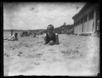 Fritz E. Bjorkman lying on the beach in a swimming costume, Port Stanley, Ontario, undated (ca. 1916-1919).