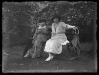 Anna E. Bjorkman and Odessa France Bjorkman seated on a bench, location unknown, undated (ca. 1918-1922).