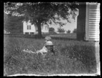 Unidentified children (Virginia and William Bjorkman?) playing in the grass, undated (ca. 1920-1925).