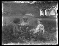 Three unidentified children (including Virginia and William Bjorkman?) playing in the grass, undated (ca. 1920-1925).