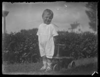Eldredge France with a toy bicycle, Chance, Maryland, undated (ca. 1919-1920).